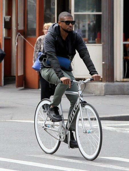 Usher Riding his bike